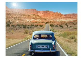 "Old man and woman driving in an oldtimer on a long clear road with red mountains in background. The license number says ""Retired""."