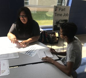 BOPiC Reality Fair Image - students at part-time job table