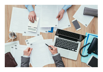business people working on tax documents at a desk