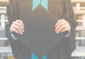 graduate holding graduation cap