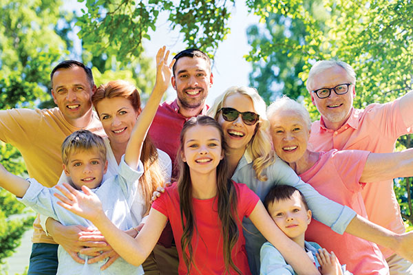 Happy family portrait in summer garden