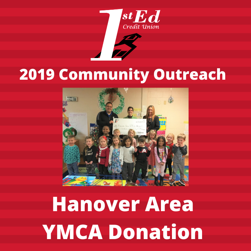 photo of children and staff donating funds for 2019 Community Outreach to Hanover Area YMCA